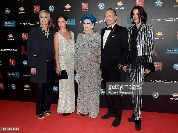 Lucia Dominguin, guest, Lucia Bose, Miguel Bose and Paola Dominguin pose during a photocall for the '4th Annual Gala Sida Barcelona 2013' held at the...