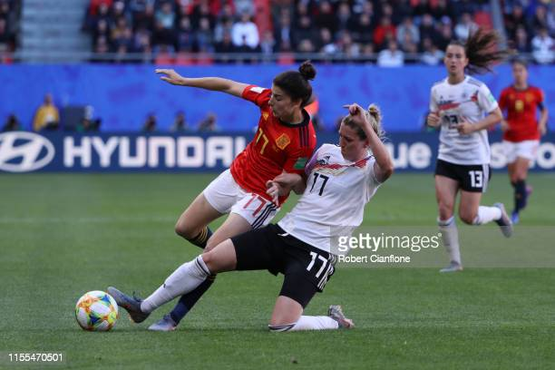 Lucia Garcia of Spain is challenged by Verena Schweers of Germany during the 2019 FIFA Women's World Cup France group B match between Germany and...