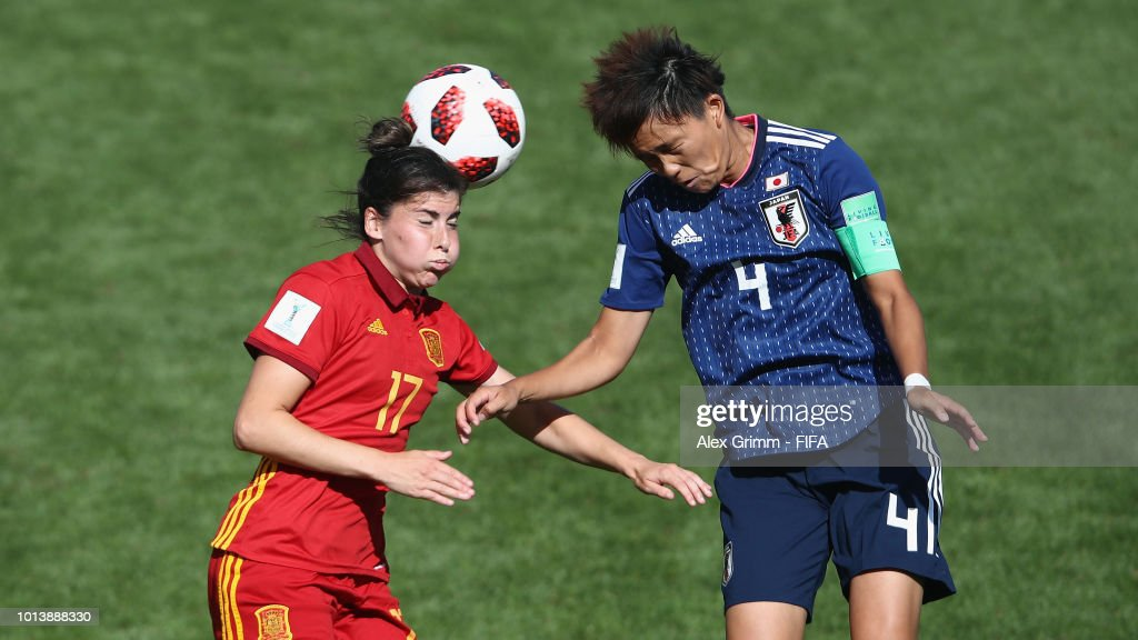 Lucia Garcia (L) of Spain jumps for a header with Moeka Minami of Japan during the FIFA U-20 Women's World Cup France 2018 group C match between Spain and Japan at Stade Guy-Piriou on August 9, 2018 in Concarneau, France.