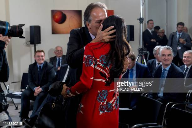 Lucia Hunt wife of Britain's Foreign Secretary Jeremy Hunt is kissed by Conservative MP Mark Field as she attends the launch of her husband's...