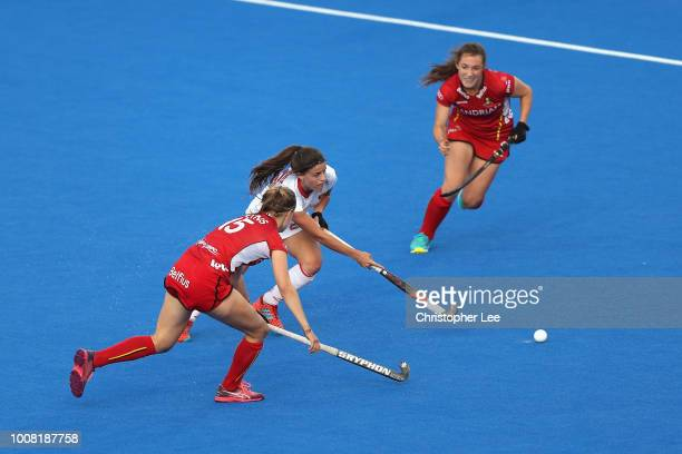 Lucia Jimenez of Spain takes on AnneSophie Weyns of Belgium during the Crossover game between Belgium and Spain of the FIH Womens Hockey World Cup at...
