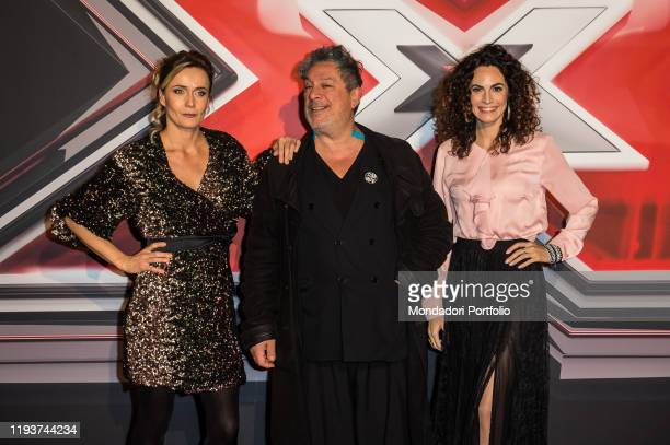 Lucia Mascino Michele Di Mauro and Enrica Guidi attend at the photocall of the final of X Factor Italia at Mediolanum forum in Milan Milan December...