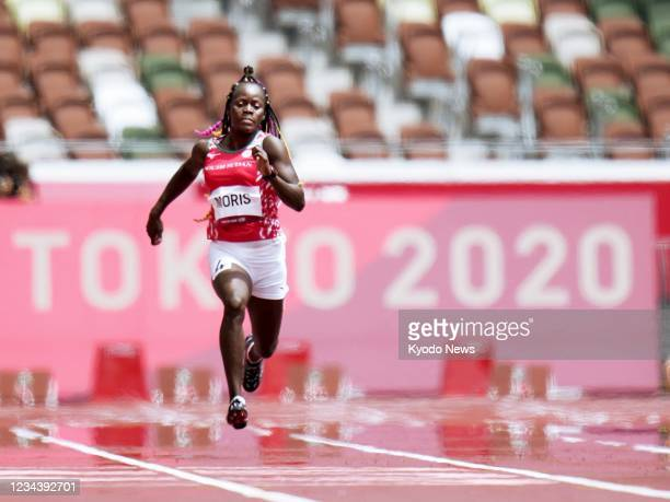 Lucia Moris of South Sudan competes in the first round of the women's 200 meters at the Tokyo Olympics on Aug. 2 at the National Stadium in Tokyo.