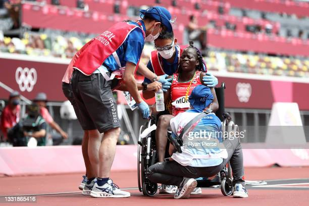 Lucia Moris of Team South Sudan receives medical attention after competing in round one of the Women's 200m heats on day ten of the Tokyo 2020...