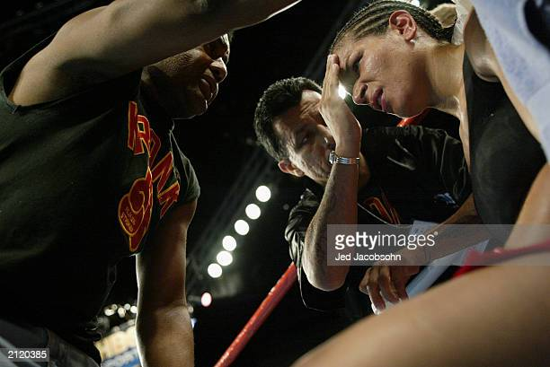 Lucia Rijker gets treated in her corner during the women's light welterweight bout against Jane Couch at the Staples Center on June 21 2003 in Los...