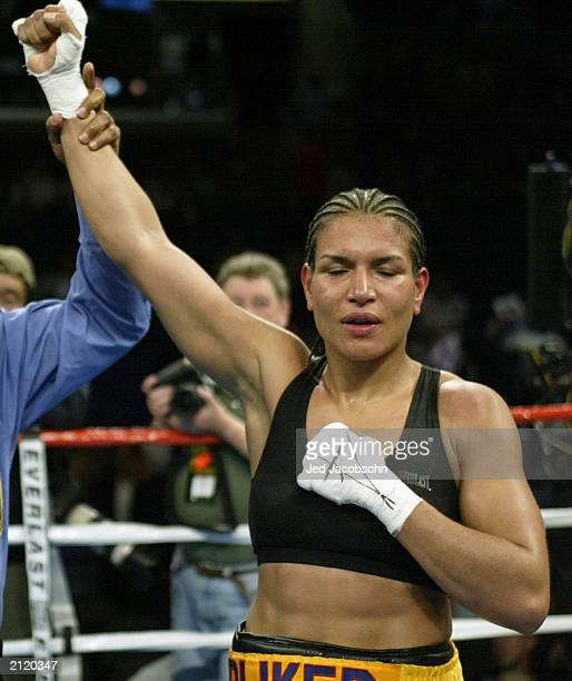 Lucia Rijker has her right arm raised in victory to the crowd by the referee after defeating Jane Couch in the women's light welterweight bout at the...