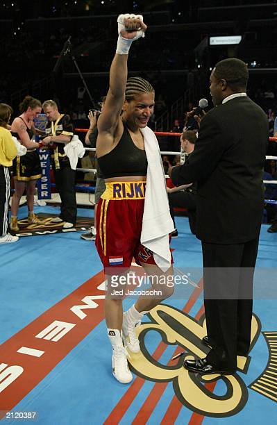 Lucia Rijker raises her right arm in celebration after the women's light welterweight bout against Jane Couch at the Staples Center on June 21 2003...