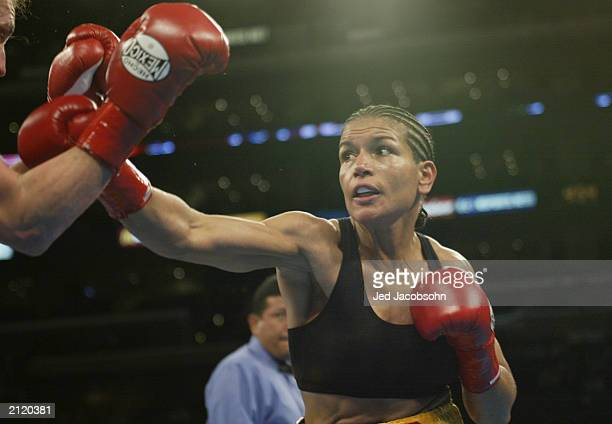 Lucia Rijker throws a punch at Jane Couch during their women's light welterweight bout at the Staples Center on June 21 2003 in Los Angeles...