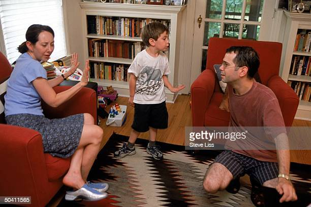 Lucian 4 years old appealing to his father David after his mother Natalie vetoed a bid to take him outside to play in their neighborhood in Chicago...