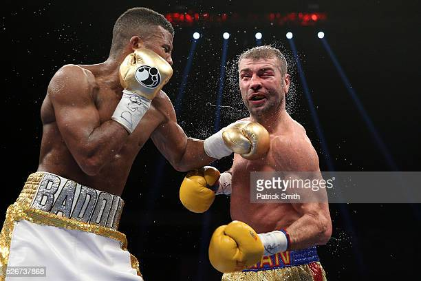 Lucian Bute of Canada is punched by Badou Jack of Sweden in their WBC super middleweight championship bout at the DC Armory on April 30 2016 in...