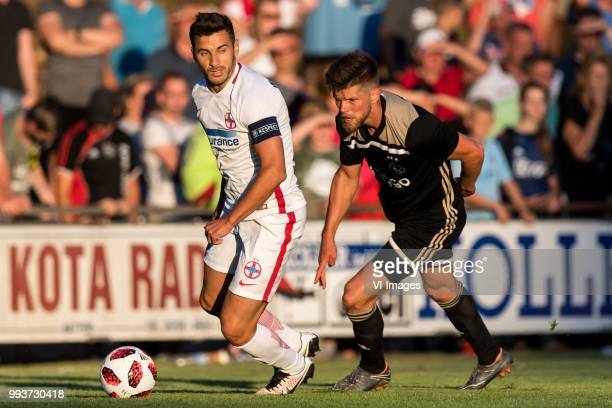 Lucian Filip of Steaua Bucharest Klaas Jan Huntelaar of Ajax during the friendly match between Ajax Amsterdam and Steaua Bucharest on July 7 2018 at...