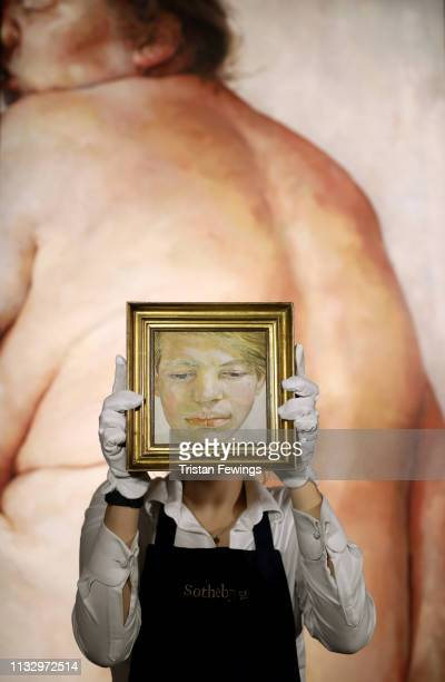 Lucian Freud's 'Head of a Boy' is pictured in front of Jenny Saville's 'Juncture' at Sotheby's on March 01 2019 in London England Sotheby's...