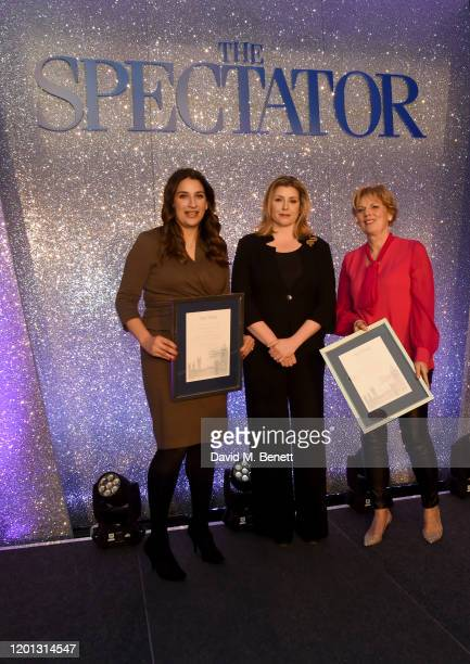 Luciana Berger and Anna Soubry win the Defector of the year Award presented by Penny Mordaunt at The Spectator Parliamentarian Of The Year Awards at...