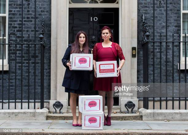 Luciana Berger MP and Natasha Devon MBE pose outside number 10 Downing Street ahead of delivering the 'Where's Your Head At' Mental Health Petition...