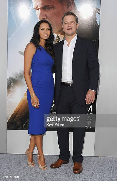 Luciana Damon and actor Matt Damon attend the premiere of TriStar Pictures' Elysium at Regency Village Theatre on August 7 2013 in Westwood California