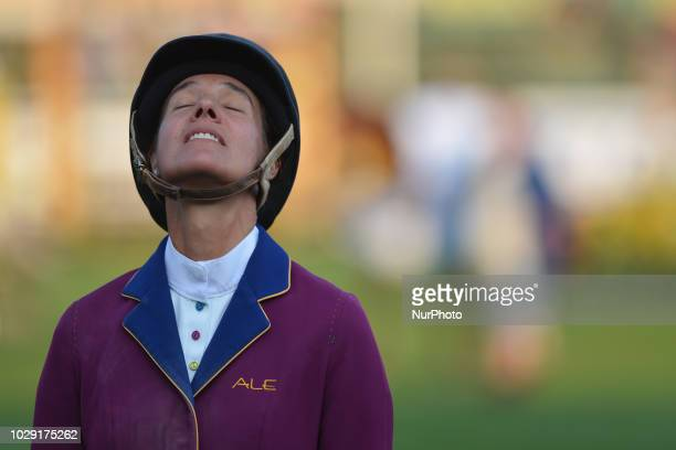 Luciana Diniz of Portugal celebrates her win after riding Camargo 2 during the Tourmaline Oil Cup individual jumping equestrian event on the third...