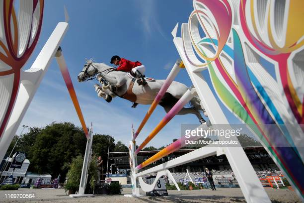 Luciana Diniz of Portugal riding Vertigo competes during Day 3 of the Longines FEI Jumping European Championship, speed competition against the...