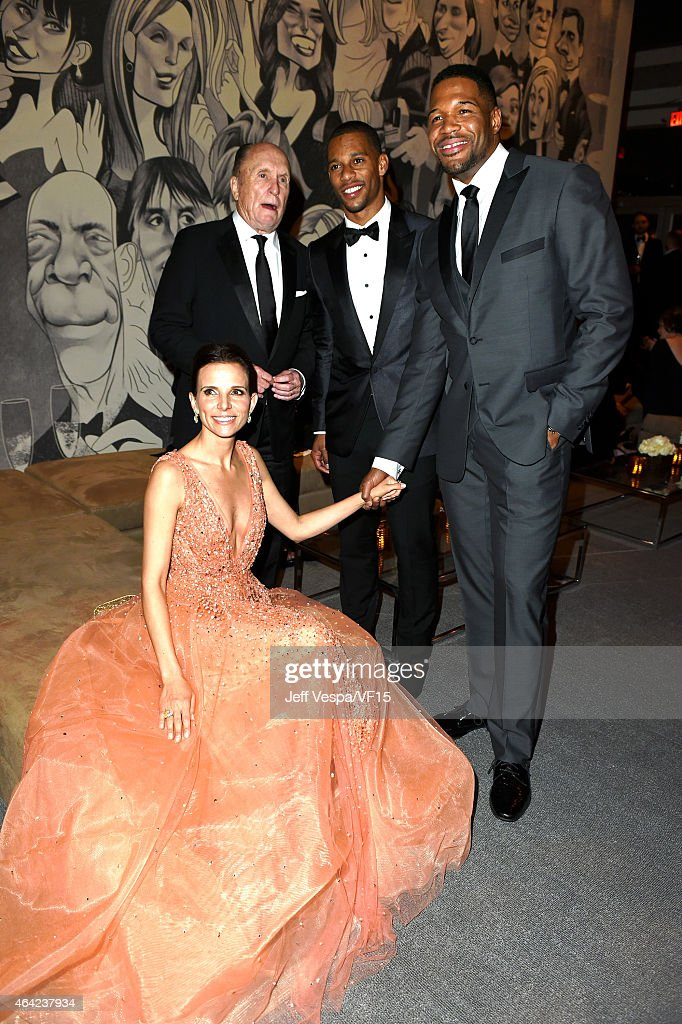 Luciana Duvall, Robert Duvall, Victor Cruz and Michael Strahan attend the 2015 Vanity Fair Oscar Party hosted by Graydon Carter at the Wallis Annenberg Center for the Performing Arts on February 22, 2015 in Beverly Hills, California.