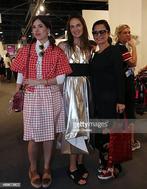 Luciana Nouis Cristiana Guimaraes and Lidia Caldas of Rio de Janeiro pose during the VIP reception for Art Basel Miami Beach at the Miami Convention...
