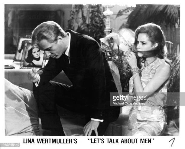 Luciana Paluzzi and a man in a scene from the film 'Let's Talk About Men', 1965.