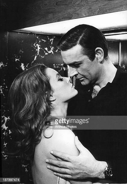 Luciana Paluzzi and Sean Connery move in toward a kiss in a scene from the film 'Thunderball' 1965