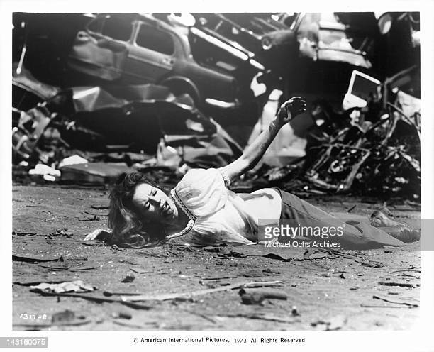 Luciana Paluzzi is the victim of mob vengeance during a shootout in an automobile junkyard in a scene from the film 'The Italian Connection' 1973