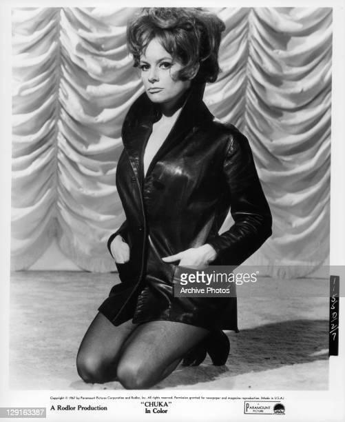 Luciana Paluzzi kneeling in a scene from the film 'Chuka' 1967