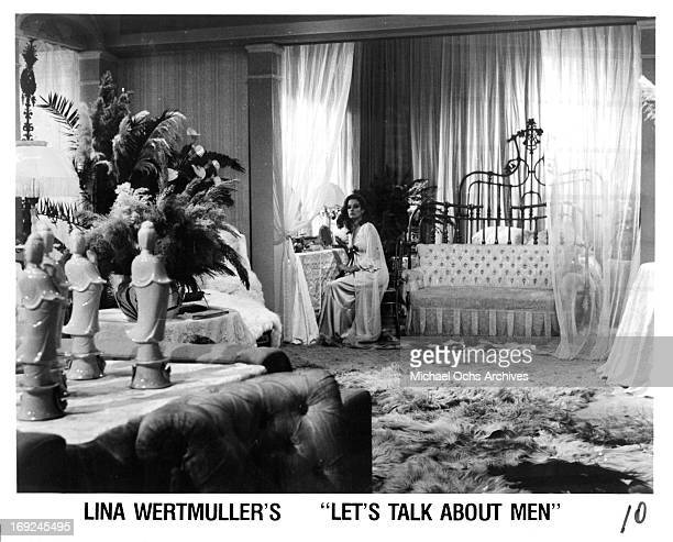 Luciana Paluzzi sits in her room in a scene from the film 'Let's Talk About Men', 1965.
