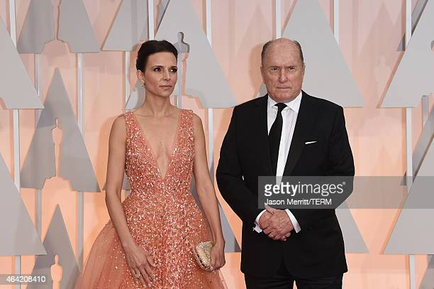 Luciana Pedraza and actor Robert Duvall attend the 87th Annual Academy Awards at Hollywood Highland Center on February 22 2015 in Hollywood California