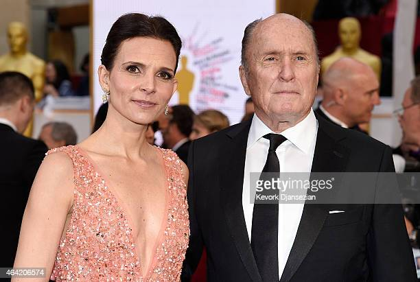 Luciana Pedraza and actor Robert Duvall attends the 87th Annual Academy Awards at Hollywood Highland Center on February 22 2015 in Hollywood...