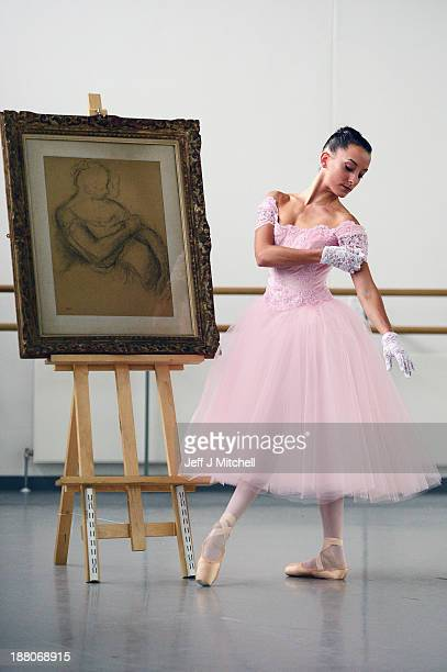 Luciana Ravizzi in her dream dress from Scottish Ballet's forthcoming premiere of Hansel Gretel stands next to a sketch of a ballerina by Edgar Degas...