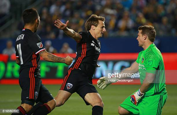 Luciano Acosta and Chris Rolfe of DC United celebrate after a goal by teammate Lamar Neagle against goalkeeper Dan Kennedy of Los Angeles Galaxy...