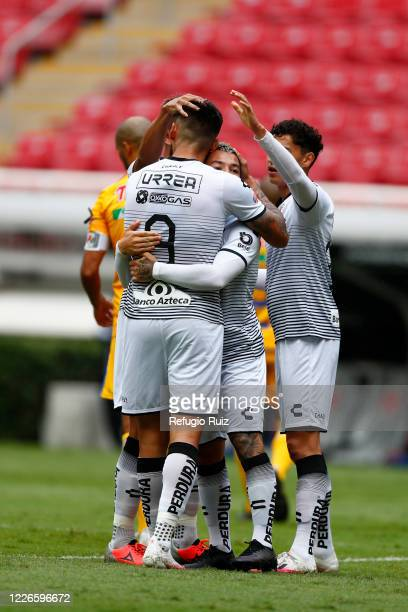 Luciano Acosta of Atlas celebrates with his teammates after scoring the first goal of his team during the match between Atlas and Tigres UANL as part...