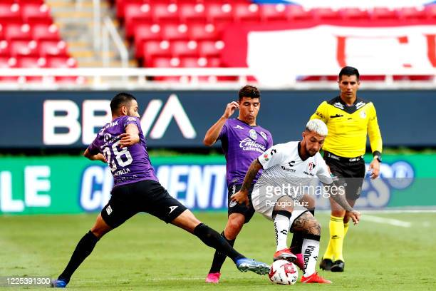 Luciano Acosta of Atlas fights for the ball with Angel Mendoza of Mazatlan during the match between Atlas and Mazatlan FC as part of the friendly...