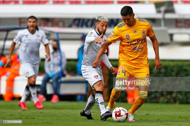 Luciano Acosta of Atlas fights for the ball with Hugo Ayala of Tigres during the match between Atlas and Tigres UANL as part of the friendship...