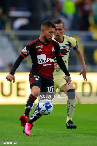 Luciano Acosta of Atlas fights for the ball with Paul Aguilar of America during the 6th round match between America and Atlas as part of the Torneo...