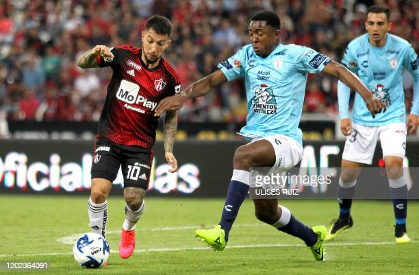Luciano Acosta of Atlas vies for the ball with Oscar Murillo of Pachuca during the Mexican Clausura 2020 tournament football match at Jalisco Stadium...