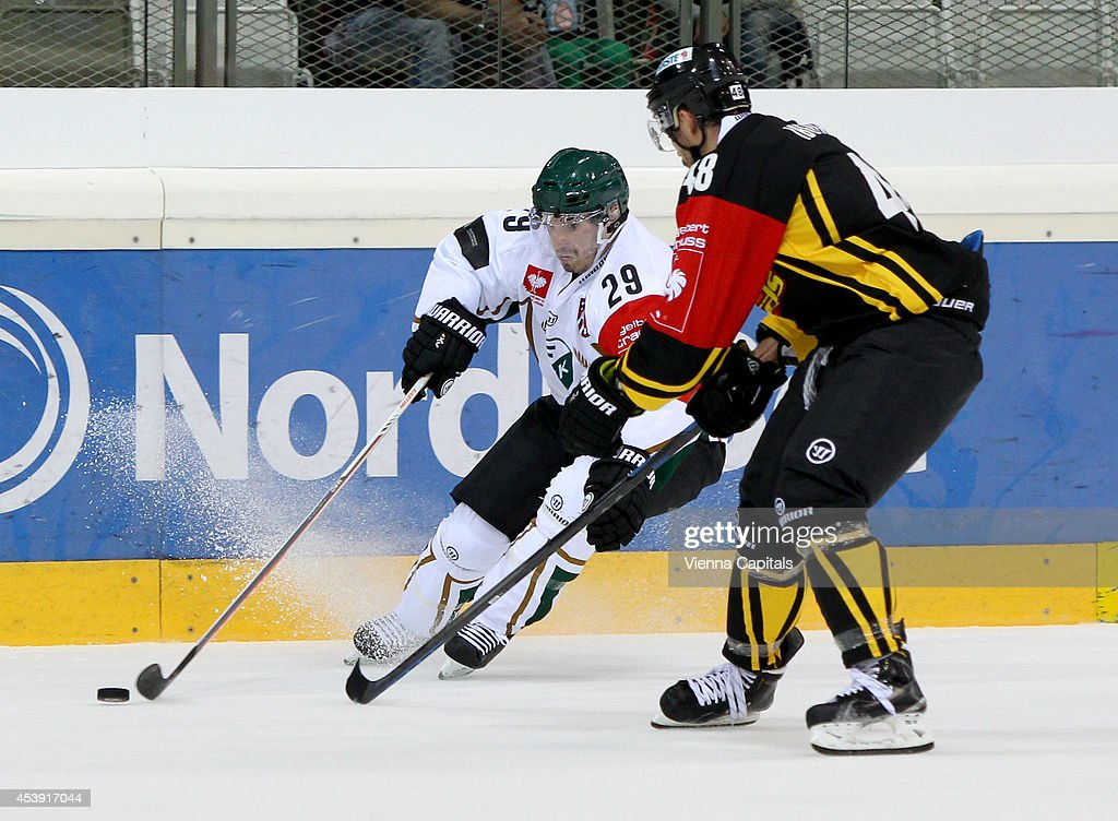 Luciano Aquino (Faerjestad) and Florian Iberer (Capitals) in action during the Champions Hockey League group stage game between Vienna Capitals and Faerjestad Karlstad on August 21, 2014 in Vienna, Austria.