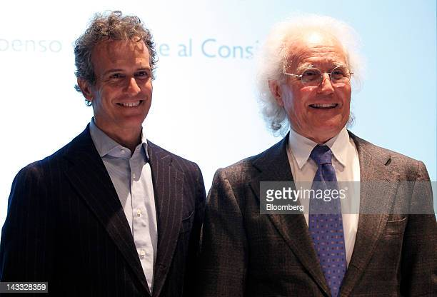 Luciano Benetton former chairman and founder of Benetton Group SpA right poses for a photograph with his son Alessandro Benetton chairman of Benetton...