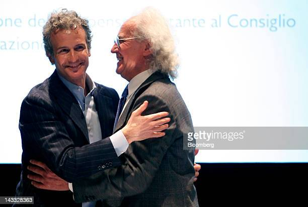 Luciano Benetton former chairman and founder of Benetton Group SpA right hugs his son Alessandro Benetton chairman of Benetton Group SpA at the end...