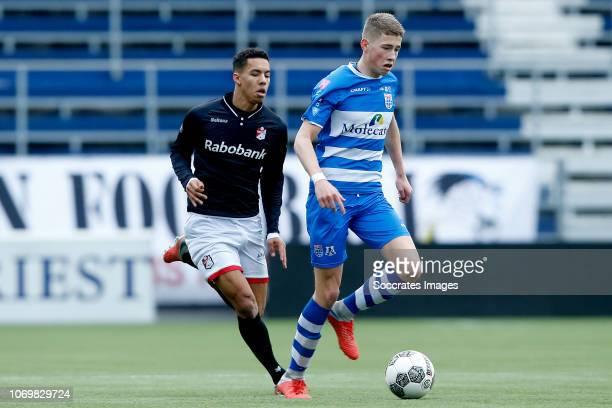 Luciano Carty of FC Emmen U19 Max Koelen of PEC Zwolle U19 during the match between PEC Zwolle U19 v FC Emmen U19 at the MAC3PARK Stadion on December...