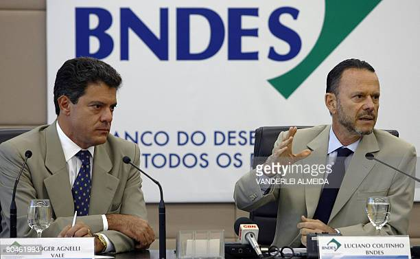 Luciano Coutinho president of Brazil's BNDES accompanied by Roger Agnelli president of Vale do Rio Doce mining company announces in a press...