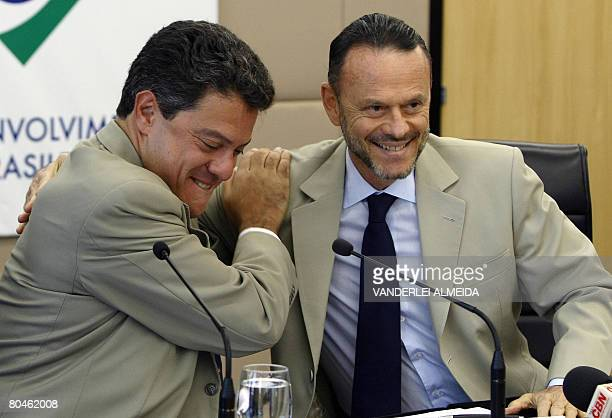 Luciano Coutinho president of Brazil's BNDES and Roger Agnelli president of Vale do Rio Doce mining company greet each other on April 1 2008 in Rio...