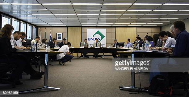 Luciano Coutinho president of Brazil's BNDES and Roger Agnelli president of Vale do Rio Doce mining company speak on April 1 2008 in Rio de Janeiro...