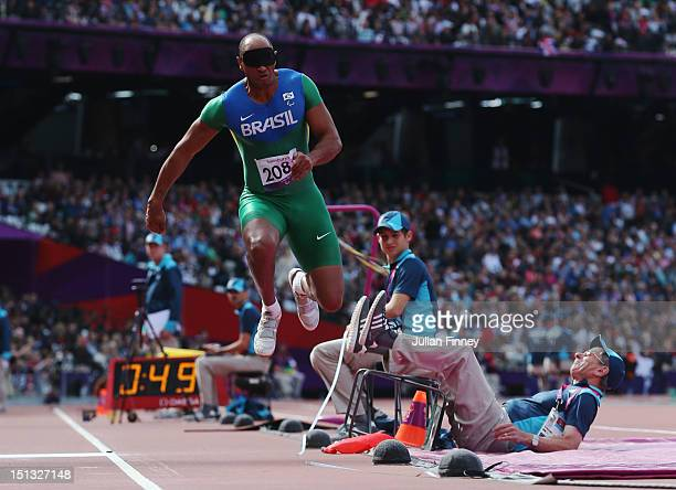 Luciano Dos Santos Pereira of Brazil collides with an offical as he competes in the Men's Triple Jump F11 Final on day 8 of the London 2012...