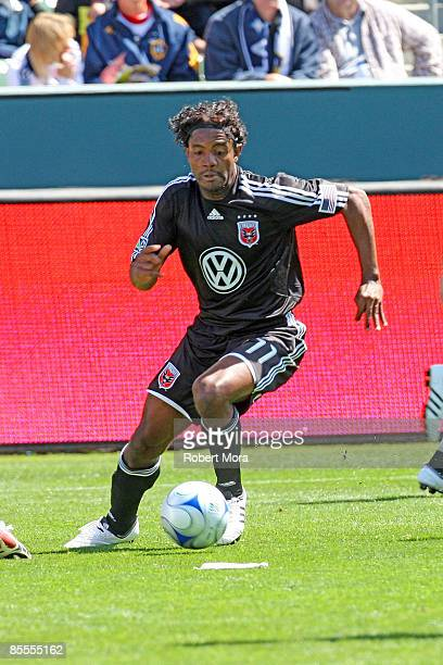 Luciano Emilio of DC United attacks the defense of the Los Angeles Galaxy during their MLS game at Home Depot Center on March 22 2009 in Carson...
