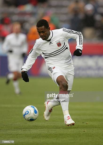 Luciano Emilio of DC United dribbles the ball against the Colorado Rapids during MLS action in the Inaugural Game at Dick's Sporting Goods Park on...