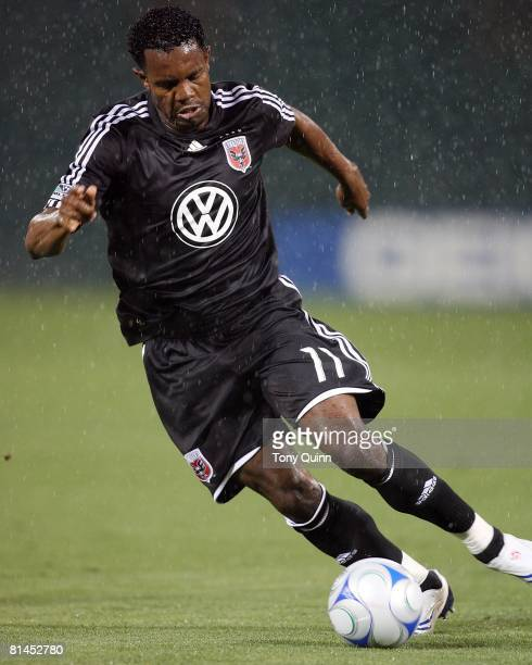 Luciano Emilio of DC United pushes forward during an MLS match against the Houston Dynamo that was postponed due to severe weather conditions at RFK...