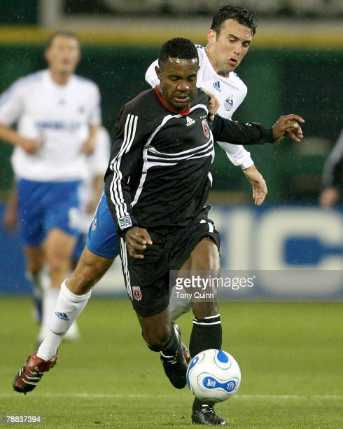 Luciano Emilio shields the ball from Kerry Zavagnin The Wizards stunned DC United at their home opener beating the hosts 42 in a heavy rain at RFK...