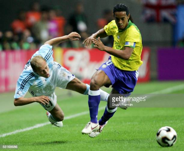 Luciano Figueroa of Argentina battles with Ronaldinho of Brazil during the FIFA 2005 Confederations Cup Final between Brazil and Argentina at the...